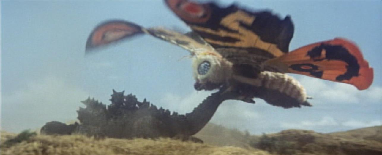 """I've never been a big fan of Toho's various """"giant insect"""" monsters. I dunno, they're just so much less imposing and creative than their more dinosaur and dragon-themed characters. While I can sort of tolerate the likes of Kumonga and Kamacuras, since they're used very sparingly, Mothra is a Toho character I've never particularly liked. I'm not sure if it's the fact that I find a giant moth to be relatively boring or if it's because she's the perpetual """"good guy"""" of the Toho universe, but I just can't stand her. Maybe it's those damn Twin Fairies that boil my blood? For whatever reason, though, Mothra is wildly popular within the Godzilla fanbase and used very, very frequently."""