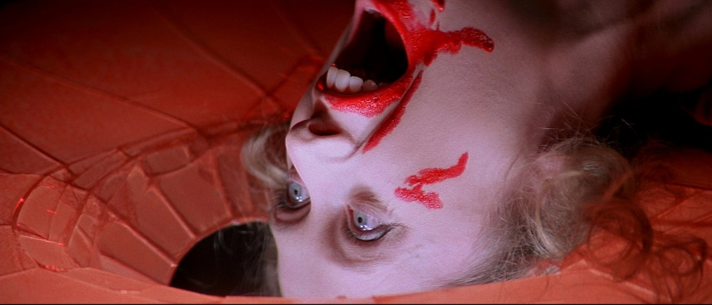 """I've seen a lot of bizarre movies in my life, but Dario Argento's Suspiria just about tops the charts. You'd be hard-pressed to find anything quite like it. The film is weird, yet it's weird in a way that makes just enough sense (which can't be said for other terminally weird films, like Naked Lunch). The first installment of the """"Three Mothers"""" trilogy; Suspiria is one of the most surreal and dreamlike horror films this side of Phantasm."""