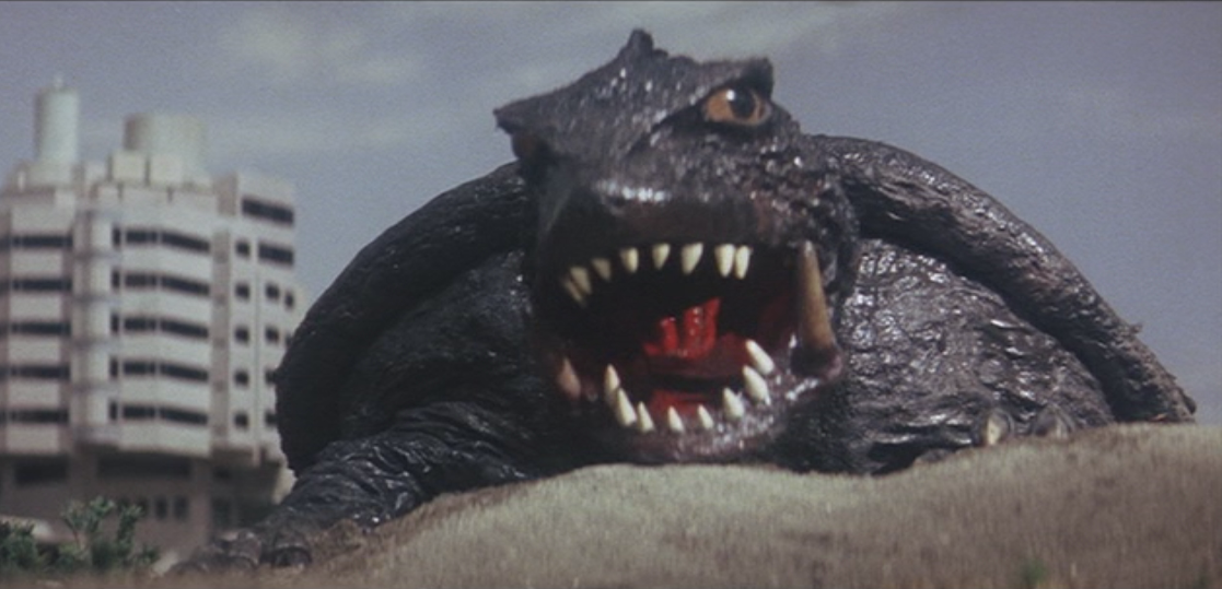 Also known as Gamera vs. Viras. Just as the Showa era Gamera series was really starting to build-up steam, doing its own thing and being really fun and wacky, Destroy All Planets had to come along and wind everything back a notch. Buried within Destroy All Planets is actually a pretty decent, if typical, vintage Gamera film. It's major failing is the over abundance of gratuitous stock footage making up about a quarter or more of the entire film. While it doesn't whore the stock footage to the extent of, say, Gamera: Super Monster, the 20+ minutes of the stuff forces the film to really spin its wheels in the middle.