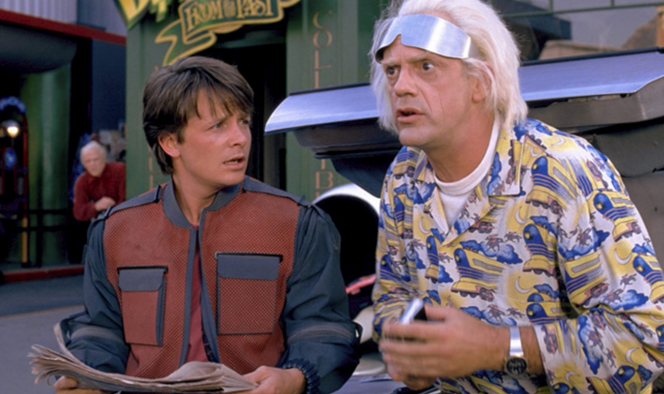 """In two days, Back to the Future fans will celebrate """"Future"""" day. In Back to the Future II, October 21, 2015 was the day that Marty (Michael J. Fox) and Doc (Christopher Lloyd) set their time traveling clock to before they jumped into the DeLorean and burned rubber. Millions of people sat fully engaged, drinking in your whimsical future."""