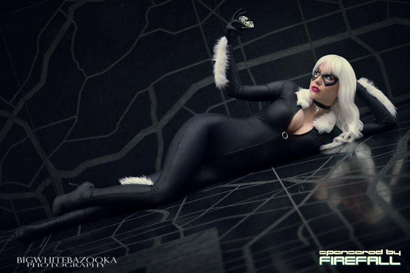 Bad luck be damned -- here's one Black Cat's path we wouldn't mind crossing. (Sorry MJ; we're sure Spidey wouldn't mind either.)  From the heels, to the fur-lined threads, to the claws and silver hair, cosplayer Crystal Graziano (who also killed it as Power Girl) makes for one ahem, purrfect cat burglar.