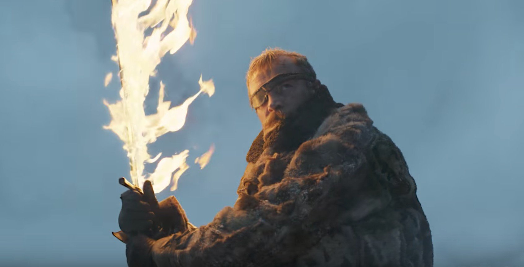 Dragons soaring and breathing fire; Jaime Lannister looking noble as he rides a galloping steed; Jon Snow and Sansa ruminating on survival and unity; and Beric Dondarrion waving a freaking flaming sword (!) are only a few of the highlights from the second official Game of Thrones trailer, which blows the first trailer right out of Blackwater Bay.