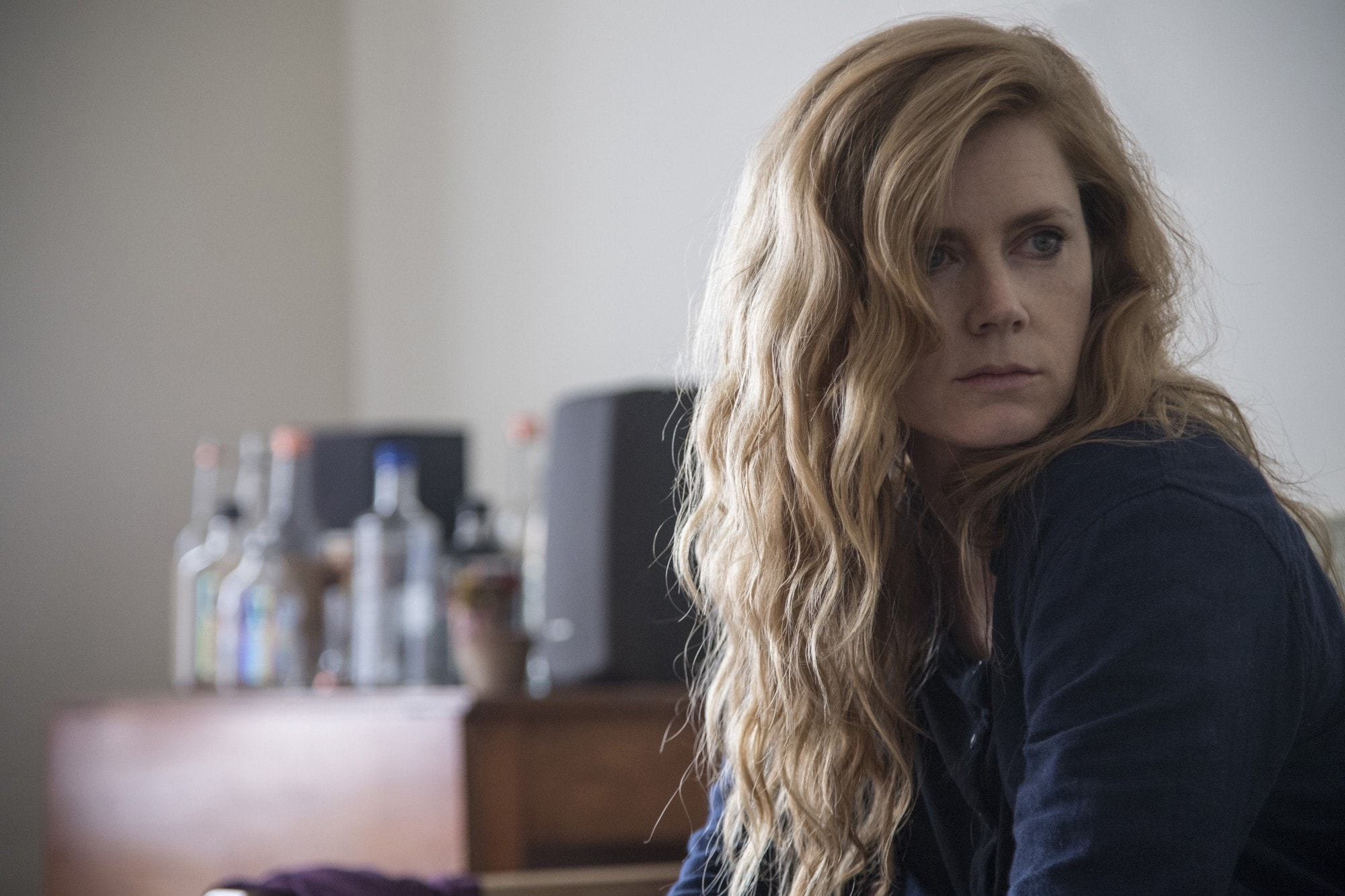 Sharp Objects moves at a meticulous pace and sets a taut atmosphere.