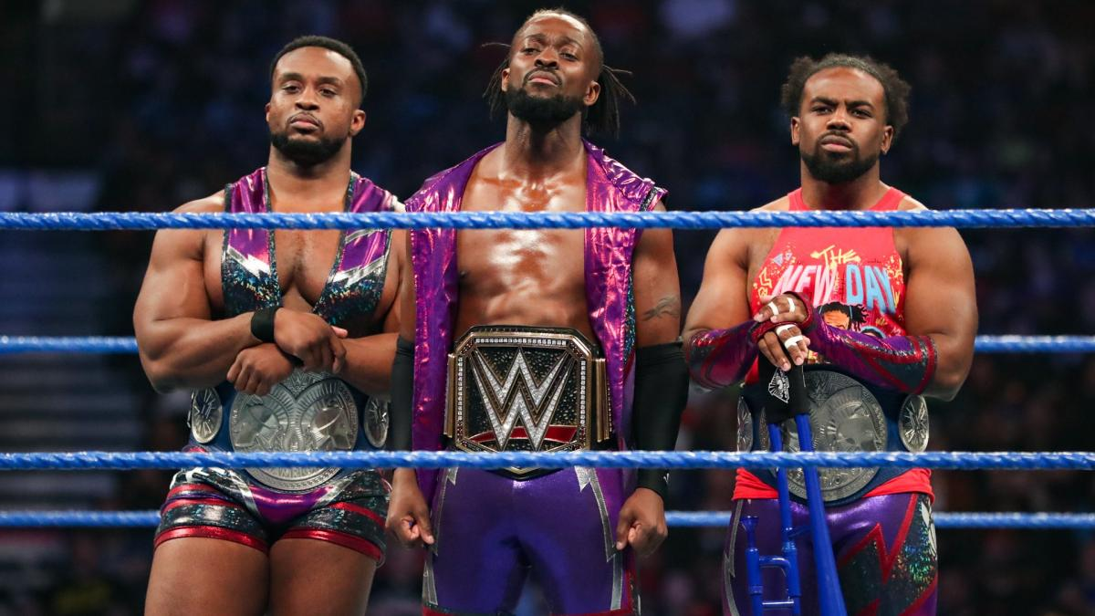 The New Day as tag teams champions and WWE Champion